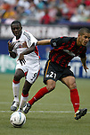 17 April 2004: Freddy Adu (9) fights his way past Craig Ziadie (21) in the second half. The MetroStars defeated DC United 3-2 at Giants Stadium in East Rutherford, NJ during a regular season Major League Soccer game..