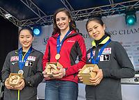24th March 2018, Mediolanum Forum, Milan, Italy;  (L-R): Wakaba HIGUCHI (JPN), Kaetlyn OSMOND (CAN), Satoko MIYAHARA (JPN) during the ISU World Figure Skating Championships, Ladies small medal ceremony at Mediolanum Forum in Milan, Italy