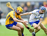 Mark Rodgers of Clare  in action against Gavin Fives of Waterford during their Munster  championship round robin game at Cusack Park Photograph by John Kelly.