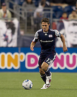 New England Revolution midfielder Ryan Guy (13) brings the ball forward. In a Major League Soccer (MLS) match, the New England Revolution defeated FC Dallas, 2-0, at Gillette Stadium on September 10, 2011.