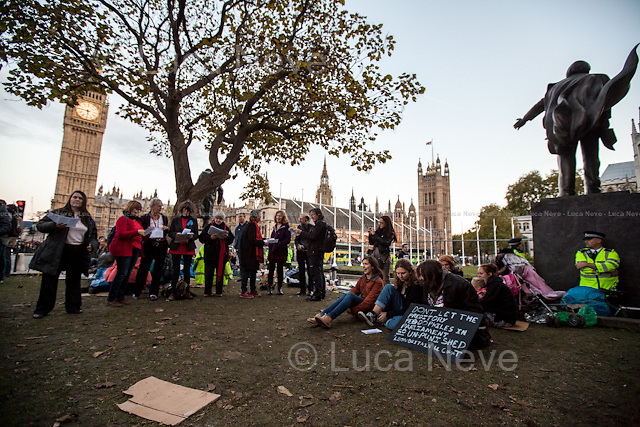 Day IX - 25.10.2014<br /> <br /> London 17-26.10.2014. A day at the Parliament Square Occupy Democracy Camp in London. Protesters have been camping in Parliament Square since the 17th of October and they will leave on Sunday the 26th. Since the beginning of the direct action protesters have been battling with the MET Police and the Greater London Authority's Heritage Wardens (provided under private contract by AOS Security) over the specific bylaw which applies to a designated area immediately surrounding and including Parliament Square and which bans sleeping equipment. Several people have been arrested, including the Green Party's Baroness Jenny Jones, member of the London Assembly who was later &quot;de-arrested&quot;. In the meantime, numerous celebrities, politicians, experts, activists, and members of the public met for conferences and debates about various topics, from democracy to climate change, to the economic crisis, to corruption, to poetry and many more.<br /> <br /> For more information please click here: http://occupydemocracy.org.uk/ &amp; http://on.fb.me/12tuv79