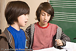 Elementary school Grade 5 arts enrichment two boys working together on assignment horizontal