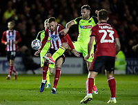 Bolton Wanderers' Daryl Murphy (centre) competing with Lincoln City's Cian Bolger (left) <br /> <br /> Photographer Andrew Kearns/CameraSport<br /> <br /> The EFL Sky Bet League One - Lincoln City v Bolton Wanderers - Tuesday 14th January 2020  - LNER Stadium - Lincoln<br /> <br /> World Copyright © 2020 CameraSport. All rights reserved. 43 Linden Ave. Countesthorpe. Leicester. England. LE8 5PG - Tel: +44 (0) 116 277 4147 - admin@camerasport.com - www.camerasport.com