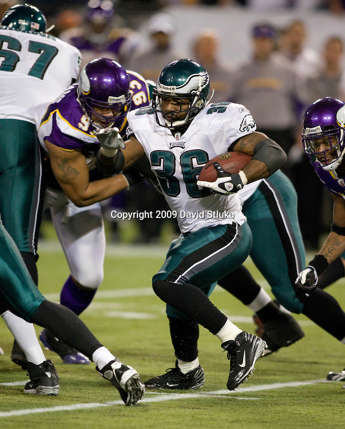 MINNEAPOLIS, MN - JANUARY 4: Defensive lineman Kevin Williams #93 of the Minnesota Vikings tackles running back Brian Westbrook #36 of the Philadelphia Eagles during the NFC Wild Card playoff game at Hubert H. Humphrey Dome on January 4, 2009 in Minneapolis, Minnesota. The Eagles beat the Vikings 26-14. (Photo by David Stluka)