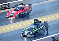 Apr. 14, 2012; Concord, NC, USA: NHRA funny car driver Alexis DeJoria (near lane) alongside Cruz Pedregon during qualifying for the Four Wide Nationals at zMax Dragway. Mandatory Credit: Mark J. Rebilas-