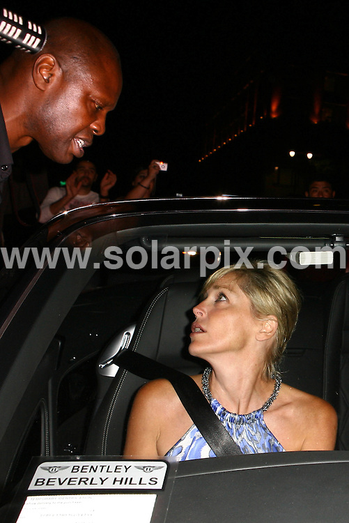 **ALL ROUND PICTURES FROM SOLARPIX.COM**.**WORLDWIDE SYNDICATION RIGHTS**.**NO PUBLICATION IN AUSTRALIA, DENMARK, GERMANY, NEW ZEALAND, RUSSIA, UK OR USA**.The Hollywood actress Sharon Stone and her boyfriend have a late night dinner at Beso Restaurant in Hollywood Los Angeles California in the USA..This pic:Sharon Stone ..JOB REF: 7096-LAP/HG       DATE:23_08_08 .**MUST CREDIT SOLARPIX.COM OR DOUBLE FEE WILL BE CHARGED* *UNDER NO CIRCUMSTANCES IS THIS IMAGE TO BE REPRODUCED FOR ANY ONLINE EDITION WITHOUT PRIOR PERMISSION*