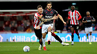 Pontus Jansson of Brentford was shown a yellow card after this foul on Reading's Sam Baldock during Brentford vs Reading, Sky Bet EFL Championship Football at Griffin Park on 23rd November 2019
