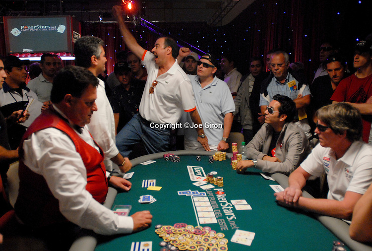 Lisandro Pablo Gallo celebrates a chopped pot with Ronald Wasiel, at right, on a three-way pot.  Alberto Andres Font Rytzner was eliminated on the hand.