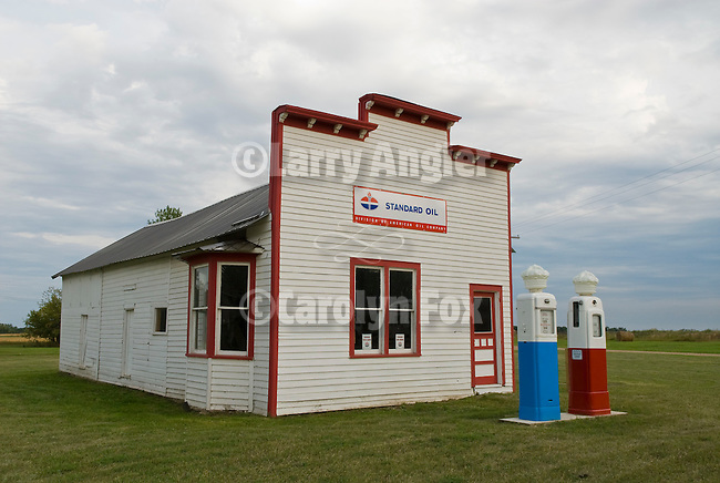Historic old Standard Oil gas station with glass Crown blue and red gas pumps; $0.419 per gallon, Solheim Service Station, Manfred, North Dakota.