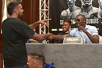 Ohara Davies makes a bet with Kugan Cassius during a Press Conference at the Landmark London Hotel on 2nd August 2018