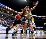 SIOUX FALLS, SD - MARCH 9: Atoe' Jackson #0 of Oral Roberts battles Kerri Young #10 of SDSU in the second half of their semi-final round Summit League Championship Tournament game Monday afternoon at the Denny Sanford Premier Center in Sioux Falls, SD. (Photo by Dave Eggen/Inertia)