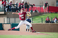 STANFORD, CA - February 20, 2016:  Stanford plays its season opener vs Cal State Fullerton at Klein Field at Sunken Diamond. Stanford won 2-0. Tristan Beck throws his first pitch at Stanford.