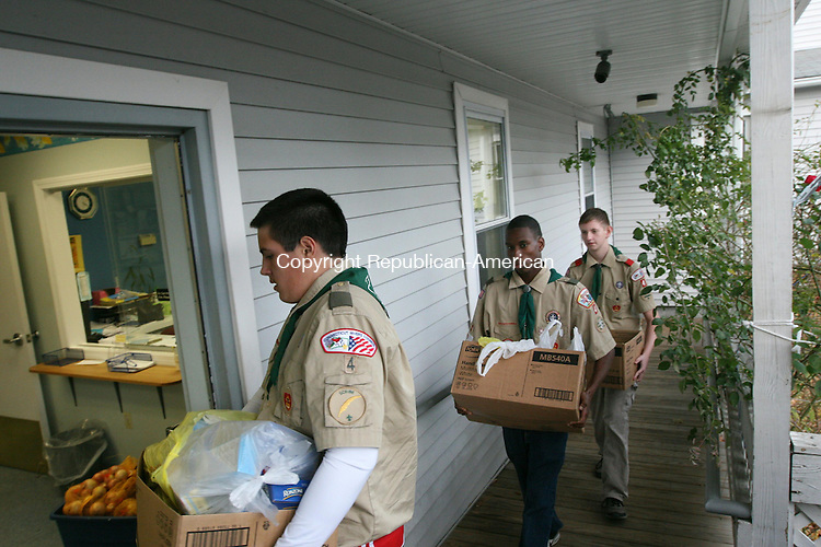 BARKHAMSTED, CT - 10 November, 2010 - 111010MO07 - Boy Scouts from Troop 4 in Torrington, from left Zach Paniati, Tremain Boles and Jonathan Magyar deliver food to FISH, Torrington's homeless shelter and one of three local food banks, on Wednesday. Jim Moore Republican-American.