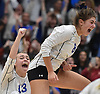 Grace Rosenberg #8 jumps for joy and she and Maggie Swegler #13 celebrate after their team's 3-2 win over Commack in the girls volleyball Class AA Long Island Championship at Farmingdale State College on Sunday, Nov. 11, 2018.
