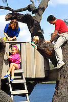 Family spending quality time together having fun while building a treehouse at home