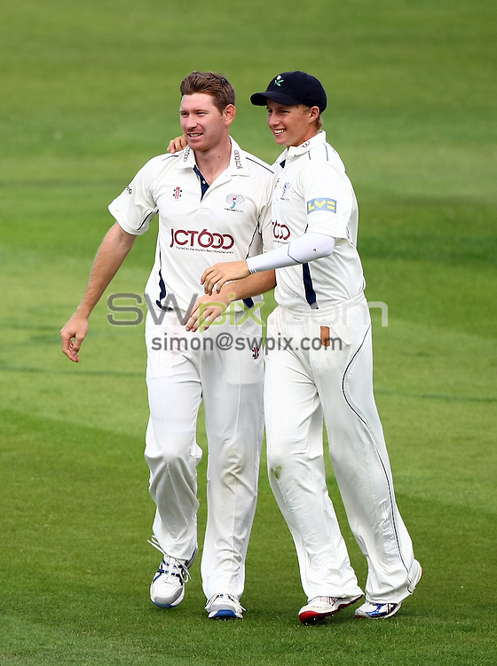 PICTURE BY VAUGHN RIDLEY/SWPIX.COM...Cricket - County Championship - Yorkshire v Warwickshire, Day 2 - Headingley, Leeds, England - 24/08/11...Yorkshire's Richard Pyrah & Joe Root celebrate the wicket of Warwickshire's Jim Troughton.