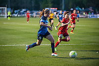 Kansas City, Mo. - Saturday April 23, 2016: FC Kansas City midfielder Heather O'Reilly (9) dribbles during a match against the Portland Thorns FC at Swope Soccer Village. The match ended in a 1-1 draw.