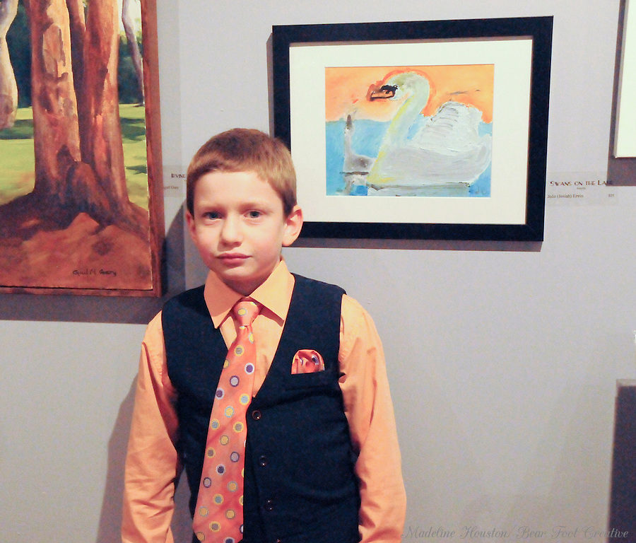 "Artist JoJo (Josiah) Ervin with his acrylic painting ""Swans on the Lake"" at Rectangle Gallery's Gala Opening for Youth Art Exhibition during Centralia, Washington's Third Thursday on October 20, 2016."