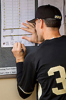 Wake Forest Demon Deacons head coach Tom Walter #32 fills out the lineup card prior to the game against the LSU Tigers at Alex Box Stadium on February 18, 2011 in Baton Rouge, Louisiana.  The Tigers defeated the Demon Deacons 15-4.  Photo by Brian Westerholt / Four Seam Images