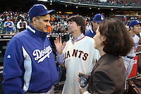 SAN FRANCISCO - SEPTEMBER 14:  Los Angeles Dodgers manager Joe Torre #6 talks with filmmakers Ken Burns and Lynn Novick, co-directors of 'The Tenth Inning', PBS's newest production, before the game between the Los Angeles Dodgers and San Francisco Giants at AT&T Park on September 14, 2010 in San Francisco, California. Photo by Brad Mangin
