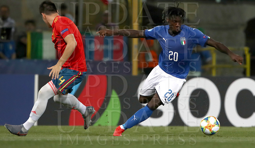 Football: Uefa European under 21 Championship 2019, Italy - Spain Renato Dall'Ara stadium Bologna Italy on June16, 2019.<br /> Italy's Moise Kean (r) in action with Spain's Jorge Meré during the Uefa European under 21 Championship 2019 football match between Italy and Spain at Renato Dall'Ara stadium in Bologna, Italy on June16, 2019.<br /> UPDATE IMAGES PRESS/Isabella Bonotto