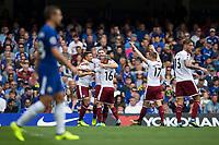 Burnley's Sam Vokes celebrates scoring the opening goal with team mates<br /> <br /> Photographer Craig Mercer/CameraSport<br /> <br /> The Premier League - Chelsea v Burnley - Saturday August 12th 2017 - Stamford Bridge - London<br /> <br /> World Copyright &copy; 2017 CameraSport. All rights reserved. 43 Linden Ave. Countesthorpe. Leicester. England. LE8 5PG - Tel: +44 (0) 116 277 4147 - admin@camerasport.com - www.camerasport.com