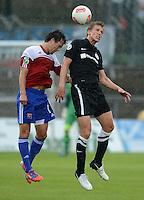 3. Fussball Bundesliga:  2. Spieltag    Saison   2012/2013   SpVgg Unterhaching  - FC Hansa Rostock   28.07.2012 Stephan Thee (li, Unterhaching) gegen Johannes Plat (FC Hansa Rostock)