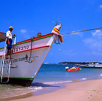 Fishing boats leisure boats at Pattaya beach,Thailand.