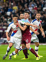 Crystal Palace Martin Kelly and West Ham's Declan Rice during the Premier League match between West Ham United and Crystal Palace at the Olympic Park, London, England on 5 October 2019. Photo by Andrew Aleksiejczuk / PRiME Media Images.