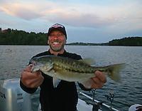 May 15, 2015; Commerce, GA, USA; NHRA pro stock motorcycle rider Matt Smith holds a spotted largemouth bass caught while fishing at Lake Lanier before the Southern Nationals at Atlanta Dragway. Mandatory Credit: Mark J. Rebilas-USA TODAY Sports