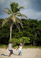 Locals play soccer on the beach of Big Corn Island, Nicaragua in April, 2009.