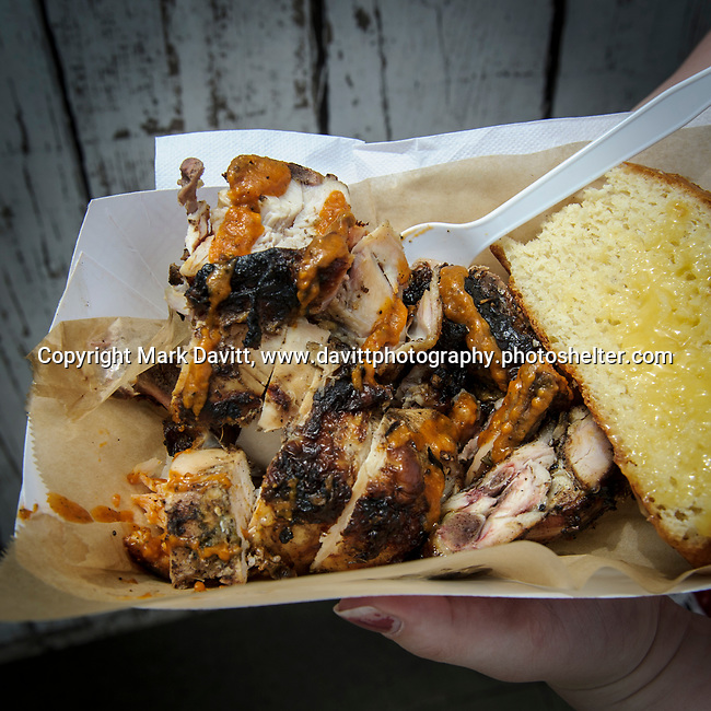 Prairie Meadows was a buss with exotic and worldly foods during its Food Truck Festival held June 17. Kurt Poorman's Miss Molly's serves Jerk Chicken boat, Jamaican style.