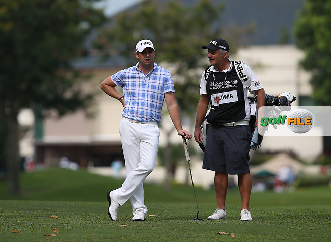 Matthew Baldwin (ENG) and caddie Juian during Round One of the The Championship 2014 from the Laguna National Golf & Country Club, Tampines, Singapore. Picture:  David Lloyd / www.golffile.ie