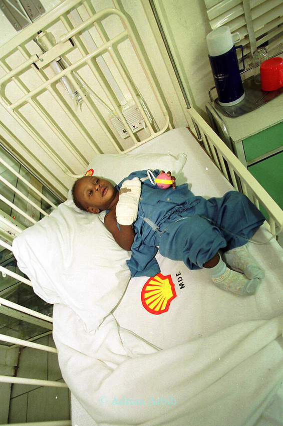 A 'Shell baby'  in   the Shell company  Hospital in Port Harcourt.  Nigeria..While Shell employees are treated with 5 star treatment  the Ogoni and other tribes from where the oil is extracted have nest to no health care at all..