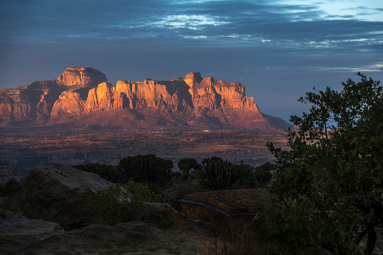 Warm sunlight of the dawn illuminates the cliffs of the Gheralta Mountain Range situated in northeast Tigrai.