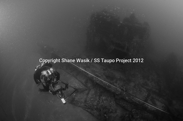 Undertaking a video survey along a baseline on the SS Taupo. (Photo by Shane Wasik Photography)