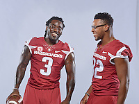 NWA Democrat-Gazette/BEN GOFF &bull; @NWABENGOFF<br /> Alex Collins (left) and fellow running back Jonathan Williams pose for a photos on Sunday Aug. 9, 2015 during Arkansas football media day at the Fred W. Smith Football Center in Fayetteville.
