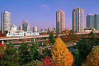 Burnaby, BC, British Columbia, Canada - Skytrain and High Rise Apartment / Condominium Buildings and Office Towers at Metrotown, Autumn, Fall