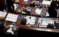 """I senatori dell'Italia dei Valori esibiscono cartelli di protesta durante una seduta nell'aula del Senato, a Roma, 20 gennaio 2010, in occasione del voto sul processo breve..Signs reading """"Berlusconi go to trial""""  and """"Justice is dead"""" are seen on desks of Italia dei Valori's senators during a plenary session at the Senate, in Rome, 20 january 2010, prior to a vote on a bill that will shorten the length of trials..UPDATE IMAGES PRESS/Riccardo De Luca"""