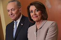 WASHINGTON, DC - JANUARY 08: Speaker of the House Nancy Pelosi (D-CA) and Senate Minority Leader Charles Schumer (D-NY) pose for photographs after delivering a televised response to President Donald Trump's national address about border security at the U.S. Capitol January 08, 2019 in Washington, DC. Republicans and Democrats seem no closer to an agreement on security along the southern border and ending the partial federal government shutdown, the second-longest in history. Photo Credit: Chip Somodevilla/CNP/AdMedia