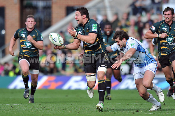 Phil Dowson passes the ball before being tackled. Heineken Cup match, between Northampton Saints and Glasgow Warriors on October 14, 2012 at Franklin's Gardens in Northampton, England. Photo by: Patrick Khachfe / Onside Images