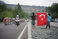 2 schoolgirls greet the peloton with a Turkish flag<br /> <br /> Tour of Turkey 2014<br /> stage 4