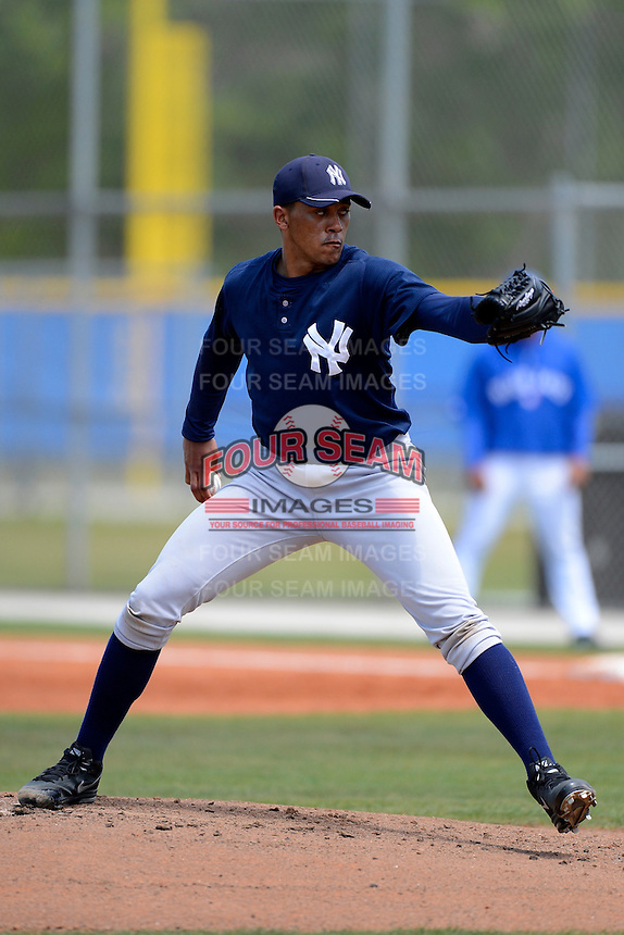 New York Yankees minor league pitcher Vicente Campos #34 during a Spring Training game against the Toronto Blue Jays at the Englebert Complex on March 19, 2013 in Dunedin, Florida.  (Mike Janes/Four Seam Images)