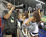 Photographer Erik Espada during Marlins Park Opening Night game between the Miami Marlins and the Cardinals on Wednesday, April 4, 2012.