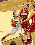 SIOUX FALLS, SD - JANUARY 16:  Marie Malloy #4 from the University of Sioux Falls eyes the basket against Mallie Doucette #10 and Drew Sannes #42 from Minnesota Moorhead in the second half of their game Friday night at the Stewart Center.  (Photo by Dave Eggen/Inertia)