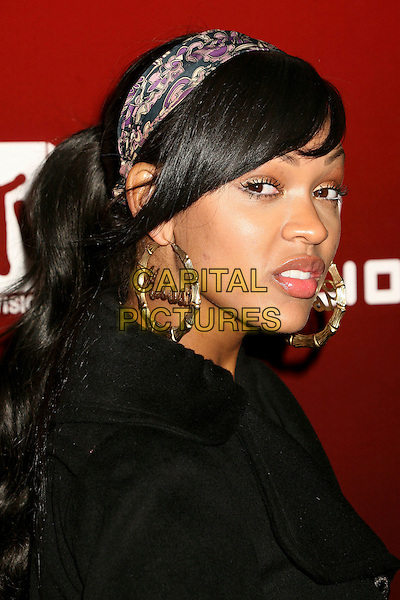 "MEAGAN GOODE.MTV Series Premiere of ""Twentyfourseven"" at Area, .Los Angeles, California, USA,.29 November 2006..portrait headshot gold hoop slogan earrings.CAP/ADM/BP.©Byron Purvis/AdMedia/Capital Pictures."