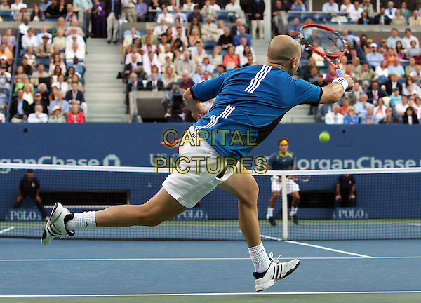 ANDRE AGASSI & ROGER FEDERER.Atmosphere before 2005 US Open Tennis Men's Championship starts, Flushing, NY. .September 11th, 2005.Photo Credit Jackson Lee/Admedia.full length sport racket blue shirt net back rear behind.www.capitalpictures.com.sales@capitalpictures.com.© Capital Pictures.