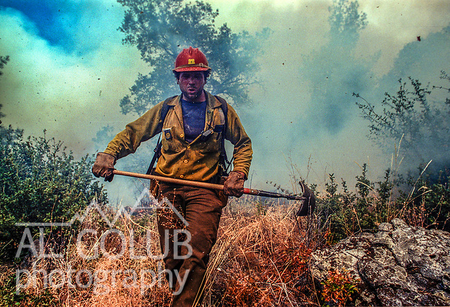 September 15, 1990 Tuolumne City, California -- Cottonwood Fire -- Stanislaus Hotshot firefighter Dave Henson moves quickly through the heavy smoke after he stopped a spot fire that jumped the line. The Cottonwood Fire was held to 2,000 acres by the fast action of fire crews.  The fire threatened several small communities. The big challenge was to make sure the fire didn't get past the Hacienda fuel break, keeping the fire out of the Tuolumne River.
