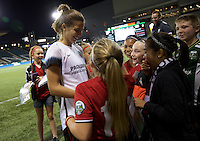 Portland, Oregon - Wednesday September 7, 2016: Portland Thorns FC midfielder Tobin Heath (17) signs autographs for fans after a regular season National Women's Soccer League (NWSL) match at Providence Park.