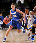 SIOUX FALLS, SD - MARCH 5:  Peyton Fallis #23 from IPFW pushes the ball past Alexis Alexander  #1 from South Dakota State during the Summit Basketball Championship Saturday in Sioux Falls.  (Photo by Dave Eggen/Inertia)